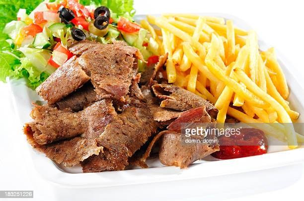 Fast food, kebab with french fries and ketchup on plate