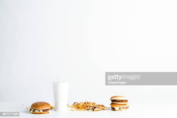 fast food leftovers on table - cliqueimages stock pictures, royalty-free photos & images