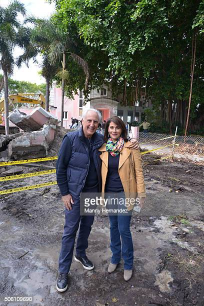 Fast food magnate Christian de Berdouare and his wife Jennifer Valoppi pose in front of the property that they now own and which was formerly the...