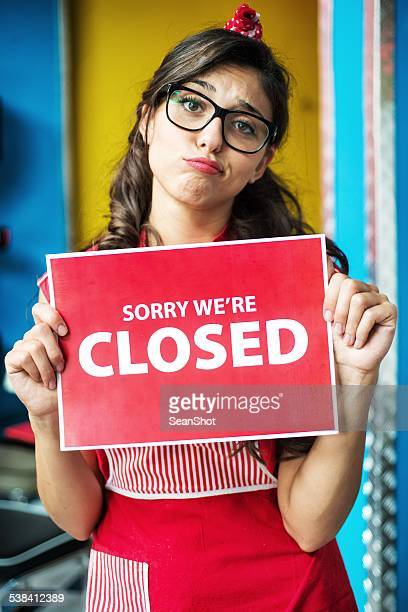 Fast Food Waitress Showing a Sign of Closing