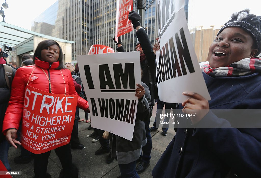 Fast food workers and supporters protest for better wages outside a Wendy's restaurant in Manhattan on April 4, 2013 in New York City. Organizers said hundreds of fast food workers were expected to walk off the job today from establishments including Wendy's, McDonald's and KFC to rally for better pay and union rights.