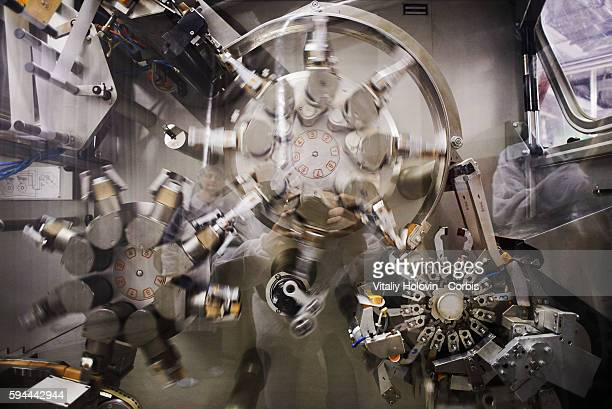 Fast machine packs a chocolate products on conveyor in factory on June 19 2016 in Vinnytsia Ukraine Roshen Confectionery Corporation is a Ukrainian...