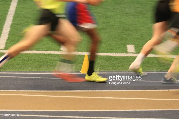 fast motion of runners on an indoor track - second place stock pictures, royalty-free photos & images