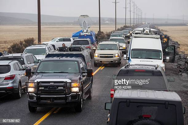 A fast moving convoy of unmarked law enforcement vehicles drives from the Malheur wildlife refuge between media vehicles approximately 4 miles from...