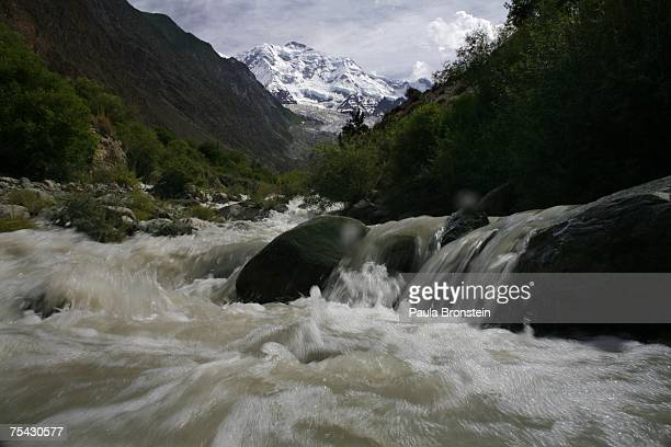 A fast moving glacial stream rushing down from Rakaposhi mountain on July 4 2007 seen from Minapin Hunza Northwest Frontier Province Pakistan This...