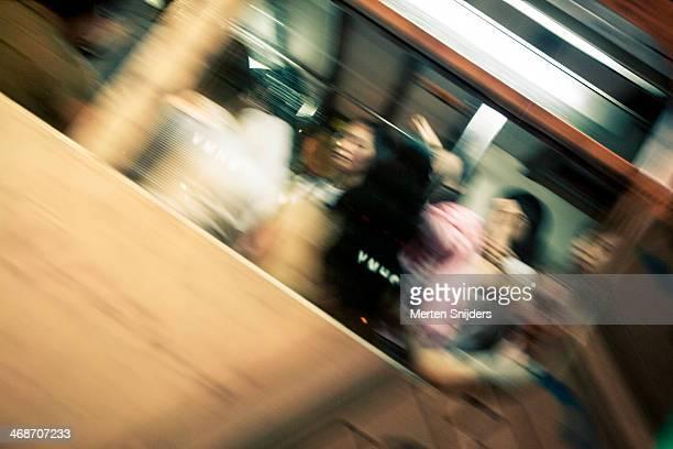 fast moving people in public transportation - merten snijders imagens e fotografias de stock