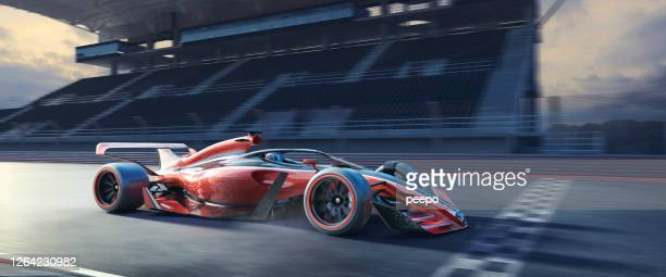 fast moving racing car over racetrack finish line near grandstand - winning stock pictures, royalty-free photos & images