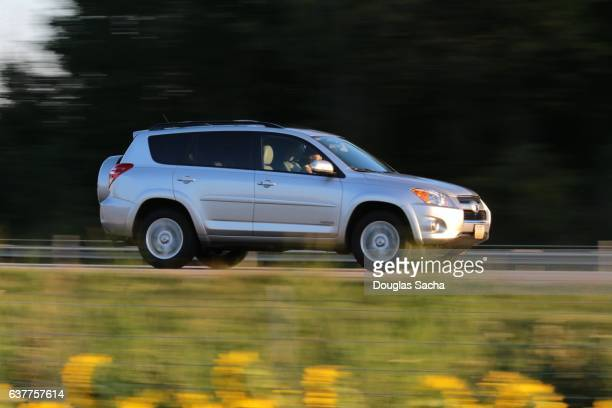 Fast moving SUV on a highway