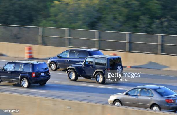 Fast moving vehicles during rush hour traffic on the highway