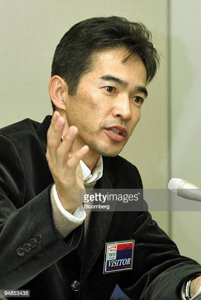 Fast Retailing Senior Vice President Naoki Ohtoma gestures as he speaks to reporters at a press briefing at the Tokyo Stock Exchange on Thursday...