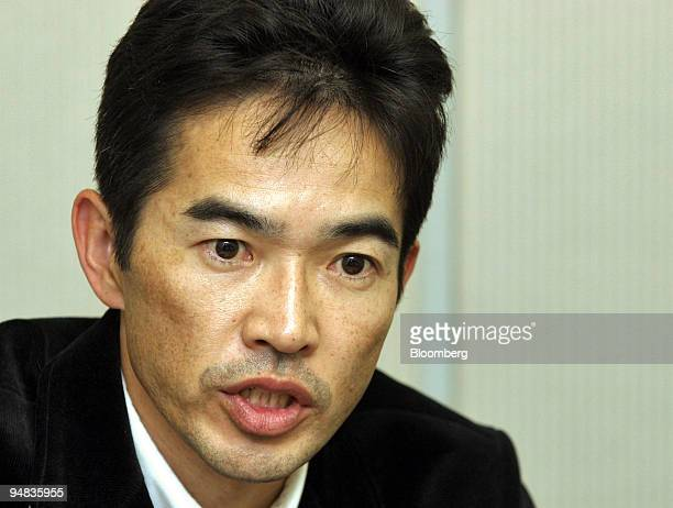Fast Retailing Senior Vice President Naoki Ohtoma speaks to reporters at a press briefing at the Tokyo Stock Exchange on Thursday January 13 2005...