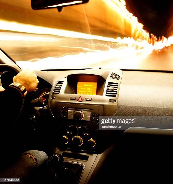 Fast speed night car driving on the light traffic. Interior