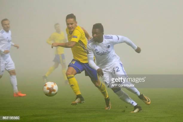 FC Fastav Zlín's midfielder from Czech Republic Daniel Holzer and FC Copenhagen's midfielder from Denmark Danny Amankwaa vie for the ball during the...