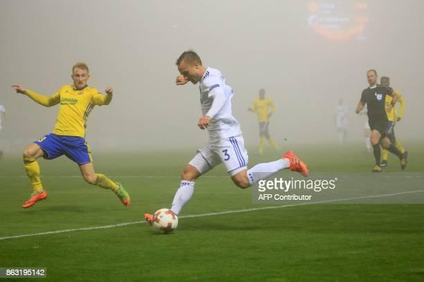 FC Fastav Zlín's midfielder from Czech Republic Milos Kopecny and FC Copenhagen's defender from Sweden Pierre Bengtsson vie for the ball during the...