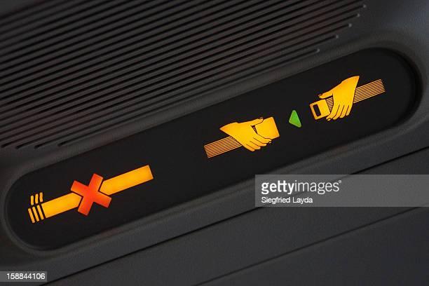 Fasten seatbelt and no smoking signs