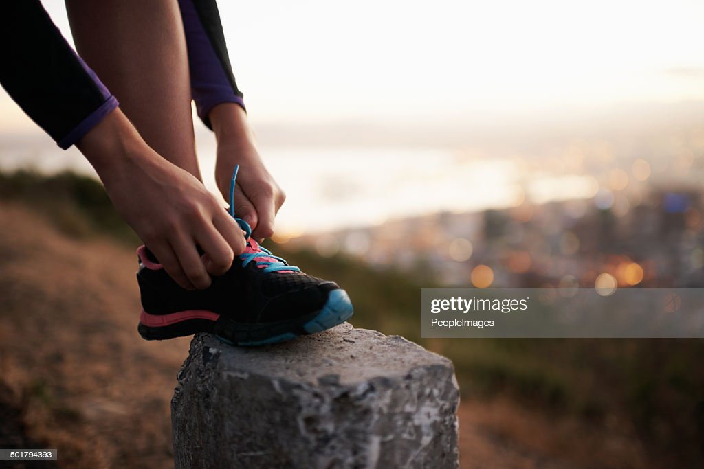 Fastening those laces for a fast-paced fun : Stock Photo