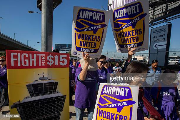 Fastfood airport home care and other workers protest to call for a higher minimum wage at Los Angeles International Airport during nationwide 'Fight...
