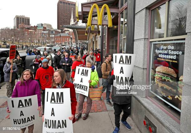Fastfood workers hold a protest rally for the 'Fight for $15' movement outside the McDonald's restaurant on Tremont Street in Boston on Feb 12 2018...