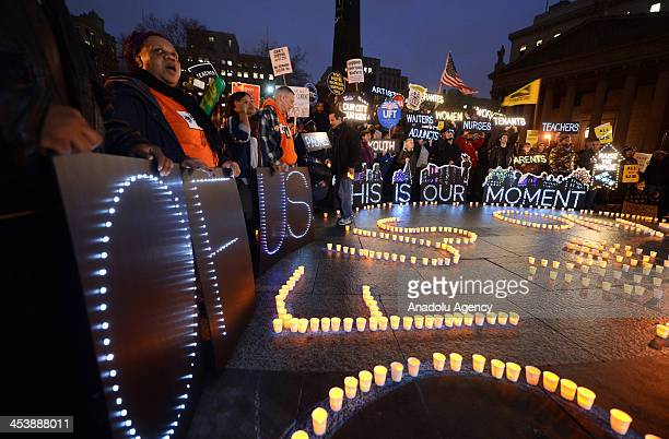 US fastfood workers protest for higher wages on December 5 2013 in New York City United States Thousands stage nationwide protests across 100 cities...