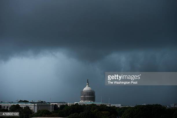 A fastmoving thunderstorm moves over the US Capitol in Washington DC on October 15 2014 The storm produced a tornado warning but that did not occur...