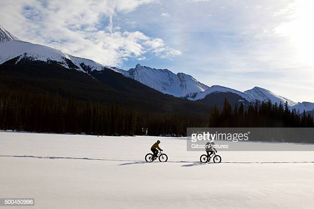 fat bike ride - following stock pictures, royalty-free photos & images