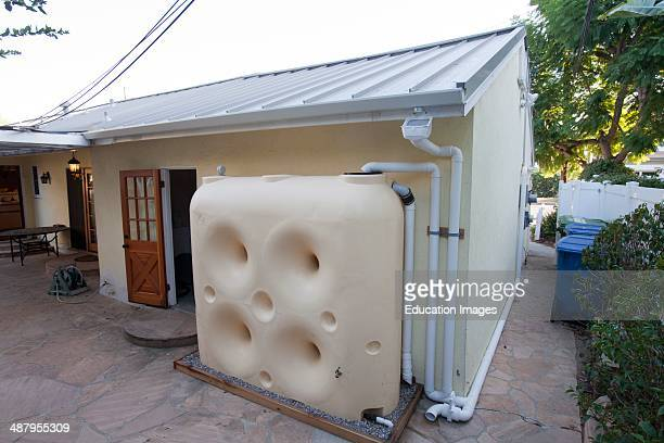 Fat Boy Water Wall 650 Gallon Above Ground Cistern collects rainwater from metal roof that facilitates runoff on Green home that is off the grid...