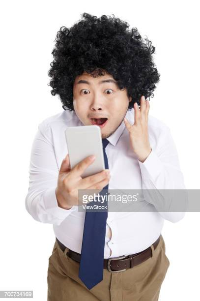 Fat business man holding a cell phone