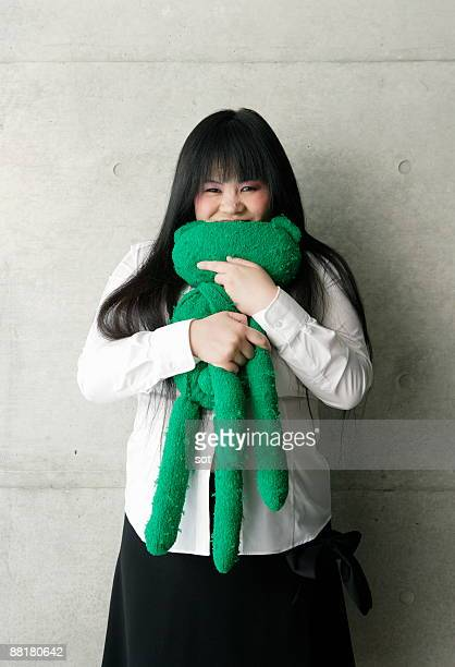 fat businesswoman holding stuffed doll - chubby asian woman stock pictures, royalty-free photos & images