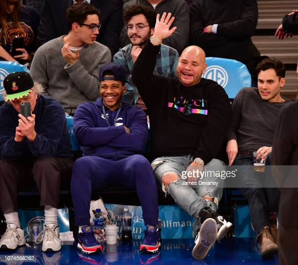 Fat Joe and guest attend Atlanta Hawks v New York Knicks game at Madison Square Garden on December 21, 2018 in New York City.