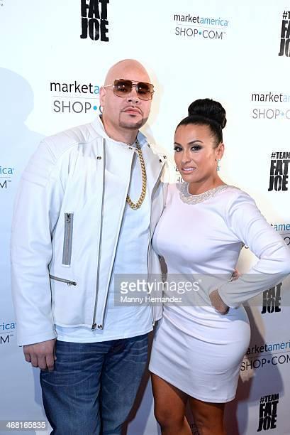 Fat Joe and Lorena Cartagena attends Team Fat Joe Celebrates Market America on February 8 2014 in Miami Beach Florida