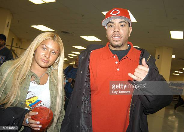 Fat Joe's wife Lorena Cartegena and Terror Squad member Armaggedon during the Jordan Classic at Madison Square Garden April 16 2005 in New York City