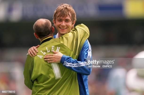 Fat Les goalkeeper Keith Allen gives Blur's Damon Albarn a big celebrity hug