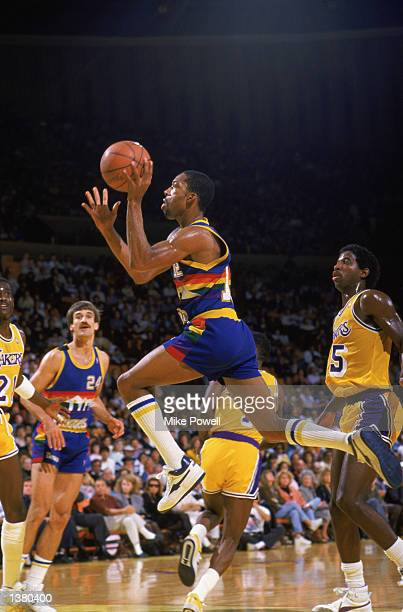 Fat Lever of the Denver Nuggets makes a layup during a game in the 1987 1988 NBA Season NOTE TO USER User expressly acknowledges and agrees that by...