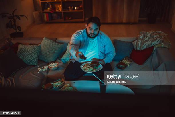fat man eating fast food - bad posture stock pictures, royalty-free photos & images