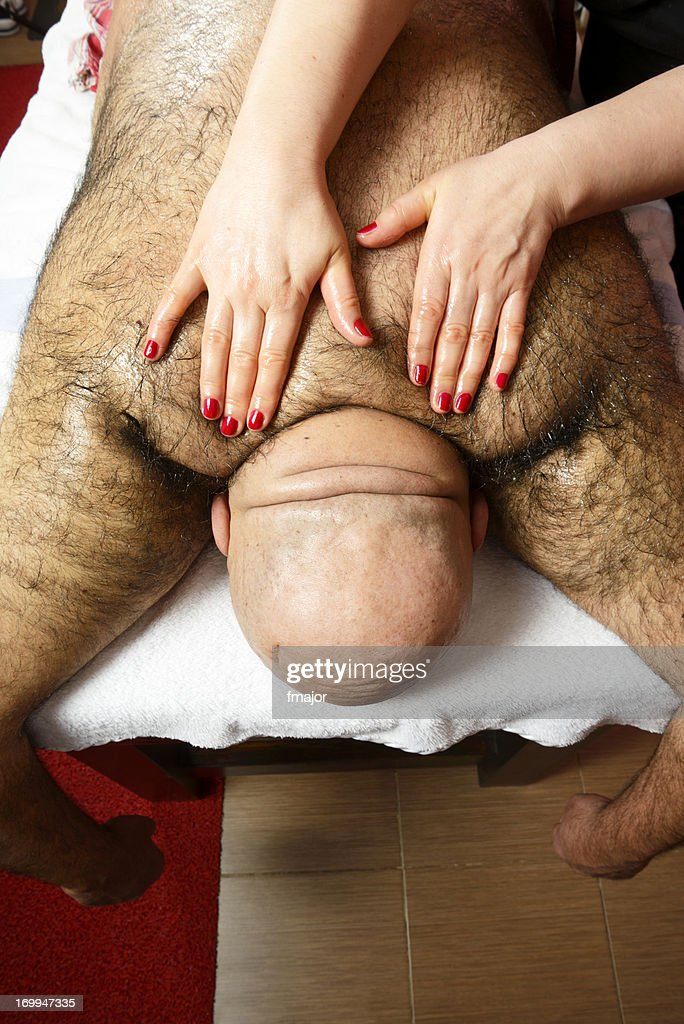 Fat man with hairy body at the massage salon : Stock Photo