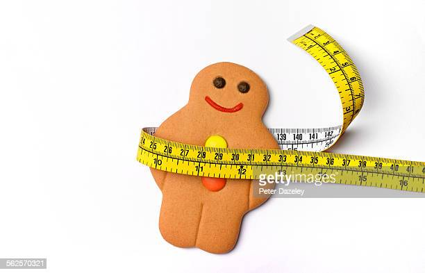 fat overweight gingerbread man - gingerbread men stock pictures, royalty-free photos & images
