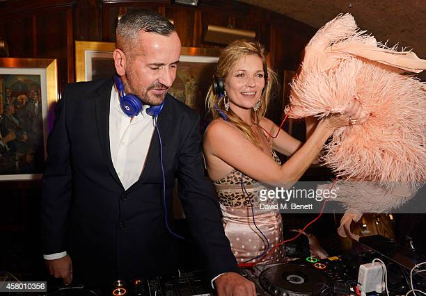 Fat Tony and Kate Moss DJ at the launch of Annabel's DocuFilm 'A String of Naked Lightbulbs' at Annabel's on October 28 2014 in London England