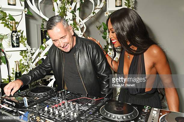 Fat Tony and Naomi Campbell DJ at the opening party for L'Eden by PerrierJouet in London's Wardour Street on September 15 2016 in London England
