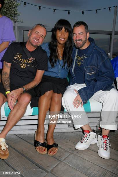 Fat Tony, Honey Dijon and Michael Maccari attend the Perry Ellis America pool party at Soho House Berlin to celebrate their European launch as part...