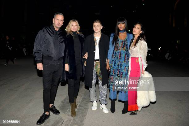 Kate Moss Naomie Campbell and Laurie Lynn Stark wearing Burberry at the Burberry February 2018 show during London Fashion Week at Dimco Buildings on...