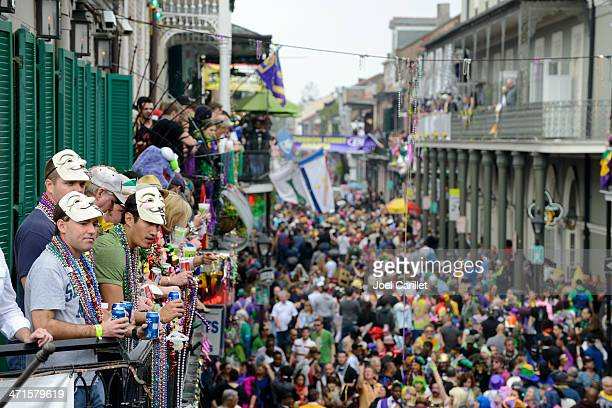 fat tuesday crowds on bourbon street - beer and beads - new orleans mardi gras stock photos and pictures
