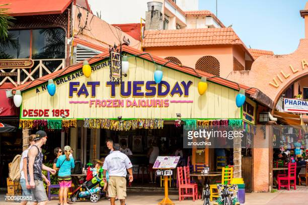 fat tuesday in cozumel with tourists and locals outside - new orleans mardi gras stock photos and pictures