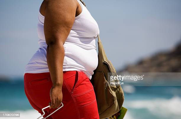 fat woman at the beach - black women stock photos and pictures