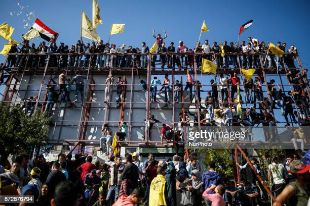 Fatah supporters take part in a rally marking during the 13th anniversary of the death of late Palestinian leader Yasser Arafat in Gaza City on...