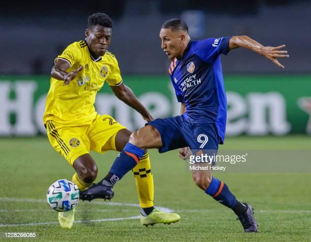 Fatai Alashe of Columbus Crew battles for the ball against Adrien Regattin of FC Cincinnati at Nippert Stadium on August 29, 2020 in Cincinnati, Ohio.