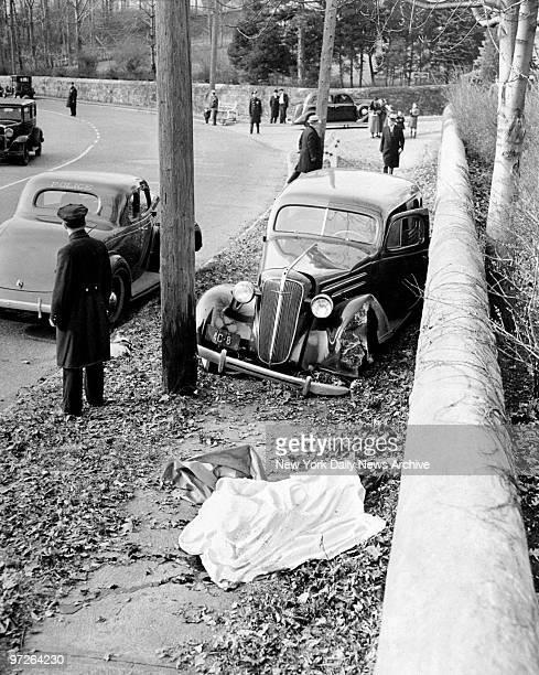 Fatal accident showing Magistrate Henry W Bridges' car stopped between telegraph pole and stone wall at Moravian Cemetary in New Dorp SI The body of...