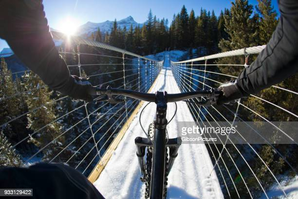 fatbike on suspension bridge - cross country cycling stock pictures, royalty-free photos & images