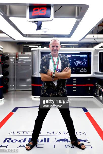 Fatboy Slim, Norman Cook poses for a photo in the Red Bull Racing garage after qualifying for the F1 Grand Prix of Singapore at Marina Bay Street...