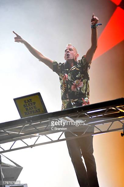 Fatboy Slim performs on stage during Day 2 of Bestival 2013 at Robin Hill Country Park on September 6 2013 in Newport Isle of Wight