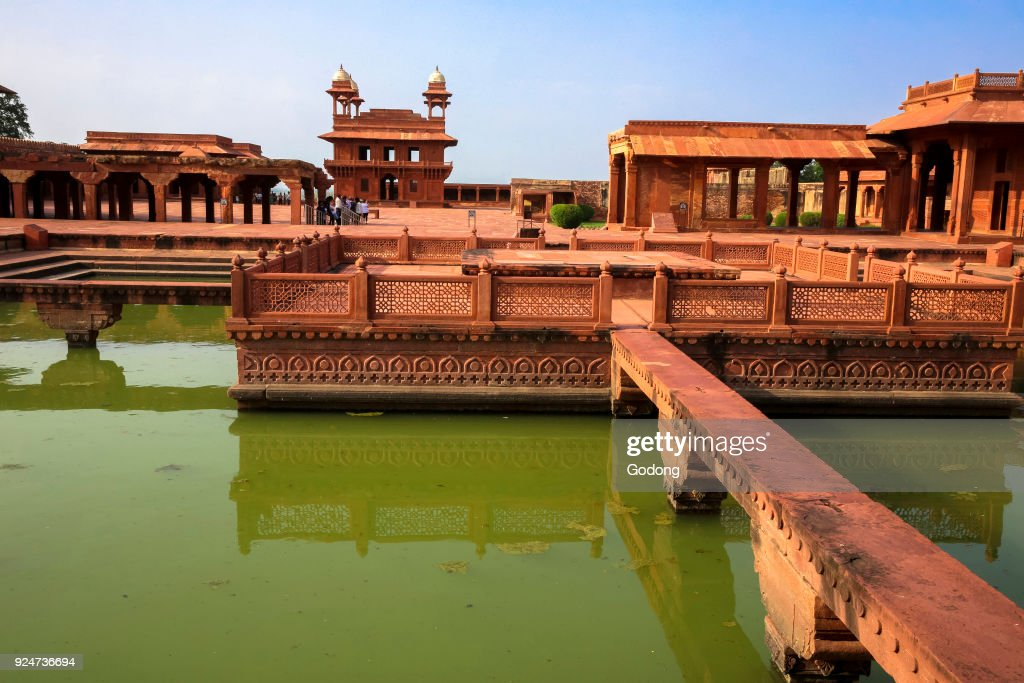 Fatehpur Sikri, founded in 1569 by the Mughal Emperor Akbar, served as the capital of the Mughal Empire from 1571 to 1585.  Imperial Palace complex. Anup Talao, an ornamental pool with a central platform and four bridges leading up to it.  India. : News Photo